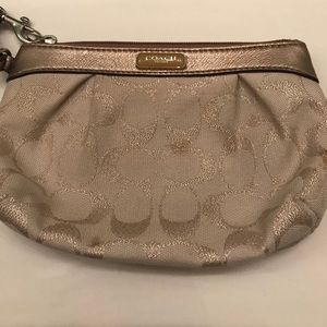 Shimmery gold large Coach wristlet